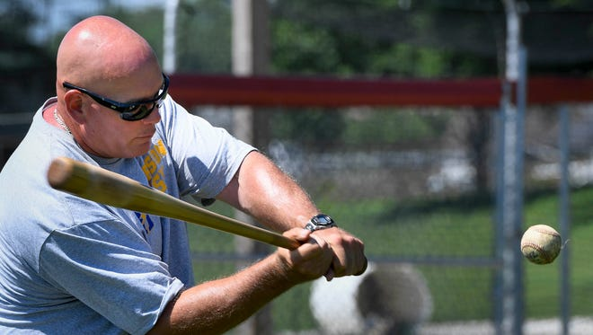 Henderson Flash manager J.D. Arndt, an assistant coach from Center College, hits balls for the outfielders as the Henderson Flash baseball summer collegiate baseball team gets ready for their debut in Huntingburg Thursday, May 30, 2017.
