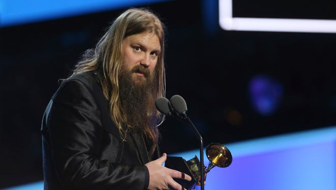 """Chris Stapleton accepts the best country solo performance award for """"Either Way"""" at the 60th annual Grammy Awards at Madison Square Garden on Sunday, Jan. 28, 2018, in New York."""