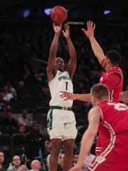 Michigan State guard Joshua Langford scores against