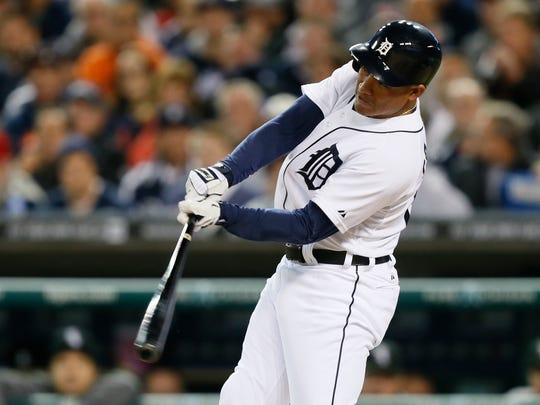 Tigers outfielder Ezequiel Carrera hits a single in the third inning against the White Sox in Detroit on September 22, 2014