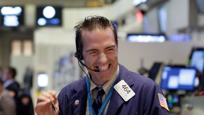Trader Gregory Rowe works on the floor of the New York Stock Exchange, Wednesday, Aug. 26, 2015. U.S. stocks closed sharply higher, giving the stock market its best day in close to four years. The Dow Jones industrial average climbed 619 points, or 4 percent on Wednesday.