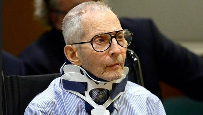 Real estate heir and documentary star Robert Durst sits during his arraignment at the Airport Branch Courthouse in Los Angeles. Los Angeles in this Nov. 7, 2016, file pool photo. Prosecutors say Durst is a danger to witnesses in his murder case. Prosecutors will ask a judge Friday, Jan. 6, 2017, to let them preserve testimony from several witnesses in case they get killed before any trial.