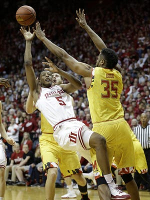Indiana Hoosiers forward Troy Williams (5) puts up a shot over Maryland Terrapins forward Damonte Dodd (35) in the first half of their B1G men's basketball game Sunday, Mar 6, 2016, afternoon at Assembly Hall in Bloomington.