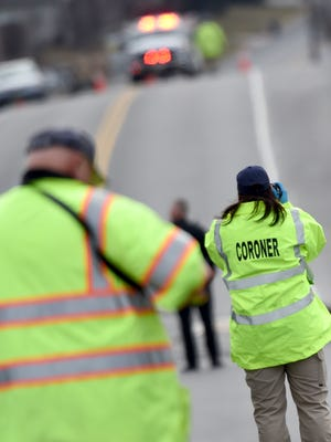 A deputy coroner was on scene taking photographs where a woman was killed Friday morning when her car veered off of Cape Horn Road just north of Red Lion and struck a house.