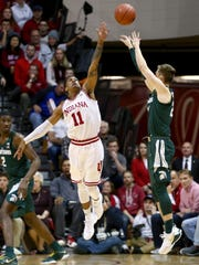 Indiana Hoosiers guard Devonte Green (11) defends as Michigan State Spartans guard Matt McQuaid (20) makes a three point basket in the first half at Assembly Hall, Saturday, Feb. 3, 2018.
