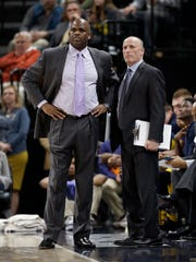 Indiana Pacers head coach Nate McMillan with assistant coach Dan Burke in the second half of their game at Bankers Life Fieldhouse on Friday, March 23, 2018. The Indiana Pacers defeated the LA Clippers 109-104.