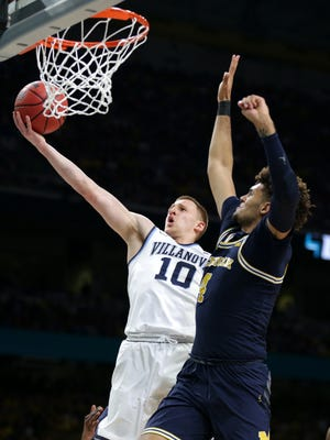 Villanova guard Donte DiVincenzo scores over Michigan forward Isaiah Livers during the national championship game April 2.
