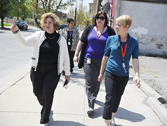York Daily Record; Family First Health employees participate in Wednesday's National Walk at Lunch Day. Research shows that walking -- and running -- each have heath benefits.