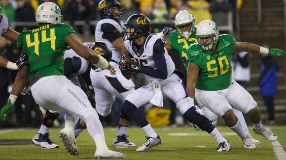 Nov 7, 2015; Eugene, OR, USA; Oregon Ducks defensive lineman Austin Maloata (50) and defensive lineman DeForest Buckner (44) close in on California Golden Bears quarterback Jared Goff (16) at Autzen Stadium. Mandatory Credit: Scott Olmos-USA TODAY Sports