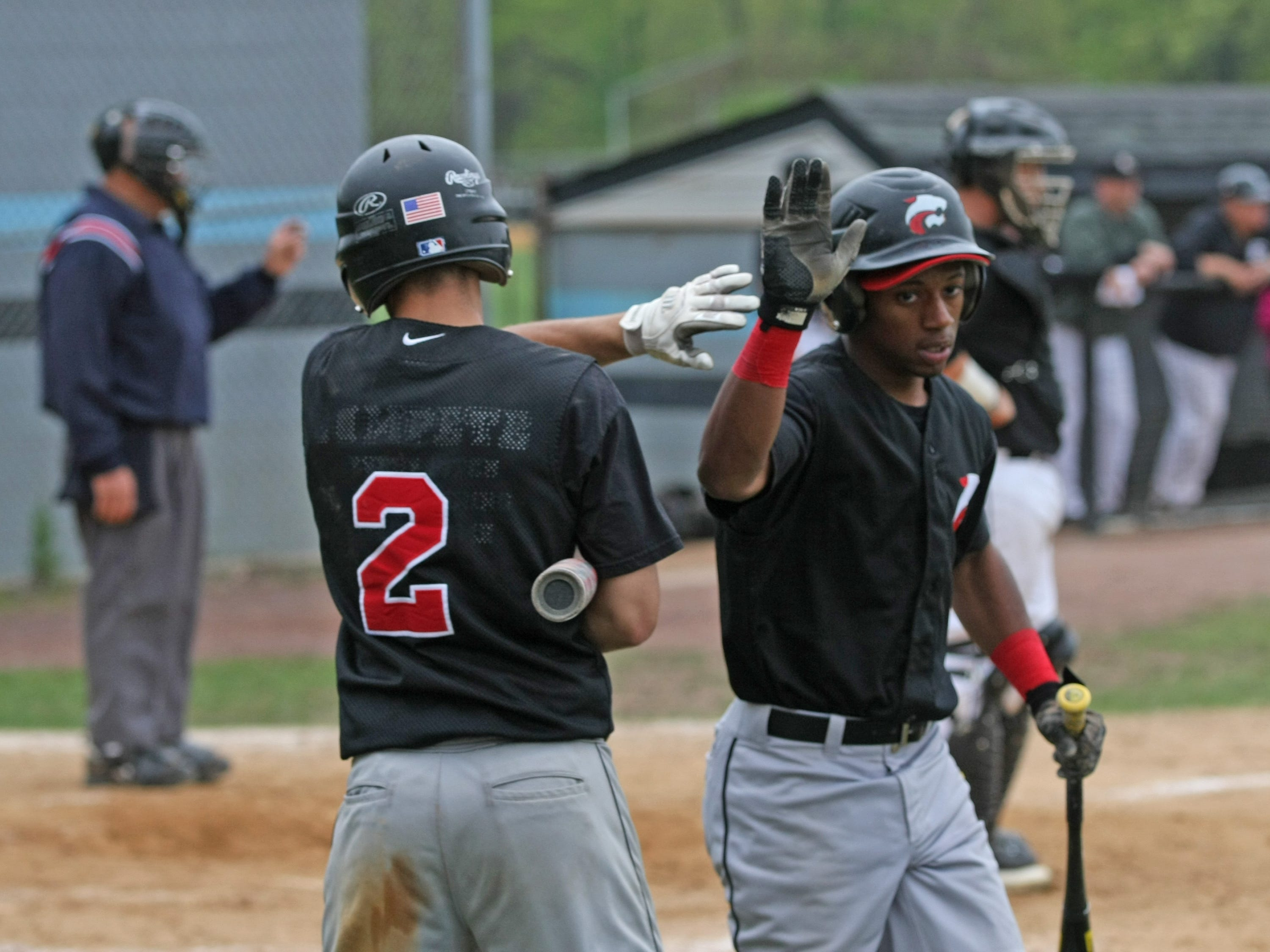Jackson Memorial's Rich Rountree, shown being congratulated last May after he scored a run last May against Toms River East, hit a game-winning grand slam in the bottom of the seventh Saturday against Jackson Liberty