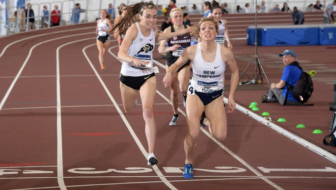Elinor Purrier of New Hampshire (right) defeats Dani Jones of Colorado to win the women's mile, 4:31.76 to 4:31.82, during the NCAA Indoor Track and Field Championships at the McFerrin Athletic Center in College Station, Texas on Saturday, March 10.
