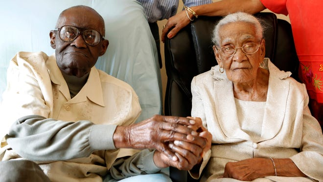 In this photo taken on Thursday, Feb. 26, 2015, Spring Valley resident Duranord Veillard and his wife Jeanne Veillard are photographed  in Spring Valley, N.Y. Duranord Veillard celebrates his 108th birthday on Saturday, Feb. 28, 2015 and his wife, Jeanne will turn 105 in May. The Veillards have been married 82 years and are one of the oldest married couples in New York. (AP Photo/The Journal News, Tania Savayan) NYC OUT, NO SALES, ONLINE OUT, TV OUT, NEWSDAY INTERNET OUT; MAGS OUT