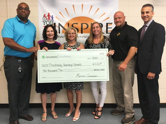 Left to right PHS Principal Jason Lester, Piscataway Superintendent Teresa Rafferty, Investor's Bank Vice-President Market Manager Irene Conte, Assistant Athletic Director Julia Schick, Athletic Director Robert Harmer, and Business Administrator David Oliveira.