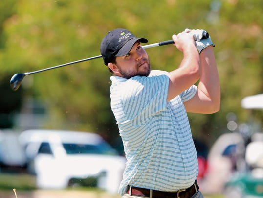 VICTOR CALZADA-EL PASO TIMES Chris Juarez watches the flight of his tee shot on the first hole Friday.