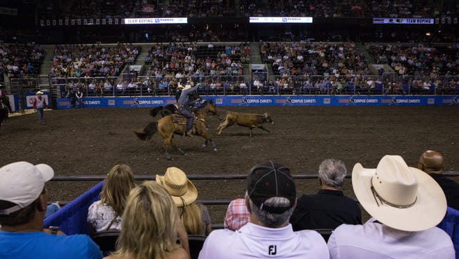 Team ropers Billy Bob Brown and Logan Medlin compete on the first night of the Corpus Christi Rodeo at the American Bank Center on Thursday, April 27, 2017.