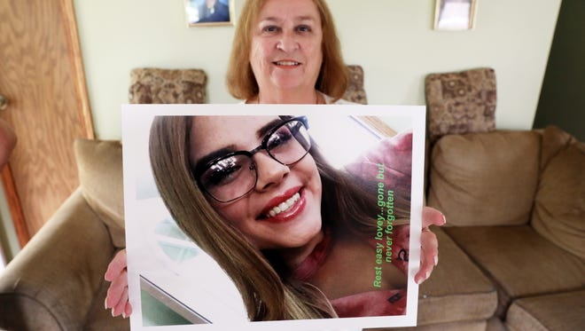 Marlene Gentile holds a picture of her granddaughter, Alivia. A trio of women have founded Gentle Giants of Ohio to help youth talk about issues like teen suicide and bullying, after Alivia took her own life in February.