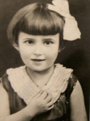 Magda Willinger  as a girl in Czechoslovakia before the Holocaust. In 1944, Willinger lived through the infamous concentration camp Auschwitz and later in a manufacturing camp to make arms for the Nazis until she was liberated by the Russians. Her two younger sisters were killed during the Holocaust.