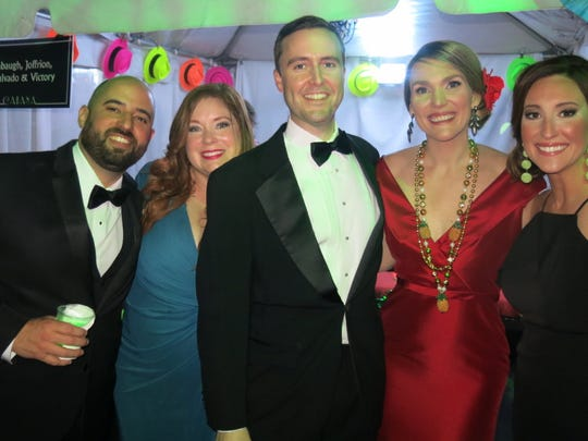 Partying in a private cabana at Krewe Justinian Grand