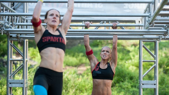 Competitors take part in a Spartan Race. The inaugural Asheville Spartan Race is Saturday at Grove Stone & Quarry in Black Mountain.