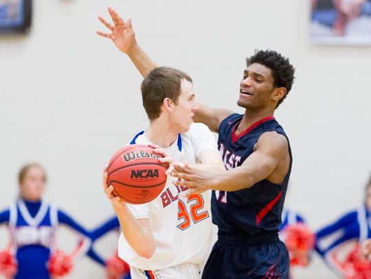 West's Ziven Clark (11) defends against Blount's Jordan