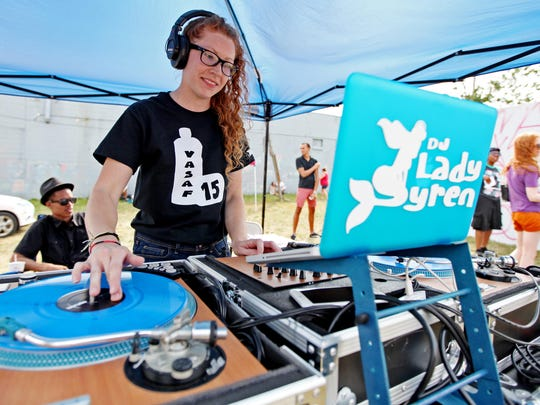 DJ Lady Syren performs during the Virginia Street Arts Festival on Saturday, August 29, 2015 on Commerce Street in Waynesboro.