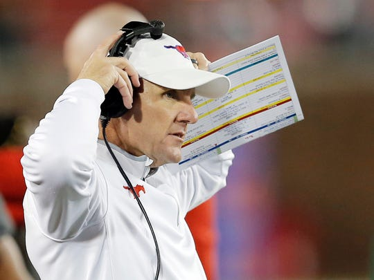 FILE - In this Nov. 19, 2016, file photo, SMU head coach Chad Morris looks on from the sidelines during the first half of an NCAA college football game, in Dallas. American Athletic Conference Commissioner Mike Aresco's dream of a true P6 seems unlikely to ever come to fruition, but if coaches like Morris, Montgomery, Norvell, Frost, Collins and Applewhite can be as successful as Herman, Rhule, Taggart and Fuente the future of the American has a chance to be more lucrative.   (AP Photo/Brandon Wade, File)
