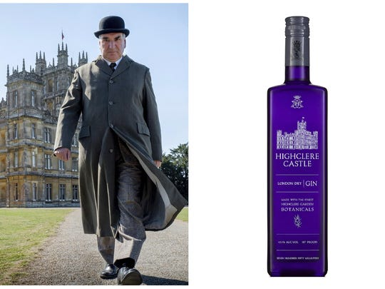 "This combination photo shows actor Jim Carter portraying Mr. Carson walking away from Highclere Castle in a scene from the film ""Downtown Abbey,"" left, and a bottle of Highclere Castle Gin."