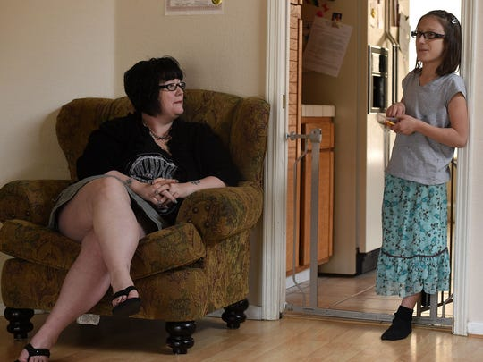 Transgender girl Cee Cee Ott talks to her mom, Shanna Ott, about school while she eats jelly beans.