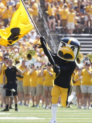 Herky waves the team flag during an NCAA college football game against Northern Illinois University on Saturday, Aug. 31, 2013 at Kinnick Stadium in Iowa City, Iowa.
