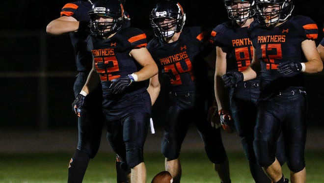Reedsville's Connor Schwahn (52) celebrates with teammates in the endzone after recovering a fumble for a touchdown against Kohler/Sheboygan Lutheran/Sheboygan Christian at Reedsville High School Friday, Sep. 1, 2017, in Reedsville, Wis. Josh Clark/USA TODAY NETWORK-Wisconsin