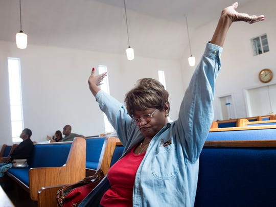 Sara Johnson raises her hands in praise during a lunch hour worship service at Corinthian Missionary Baptist Church on Wednesday, Nov. 9, 2016, in Nashville.