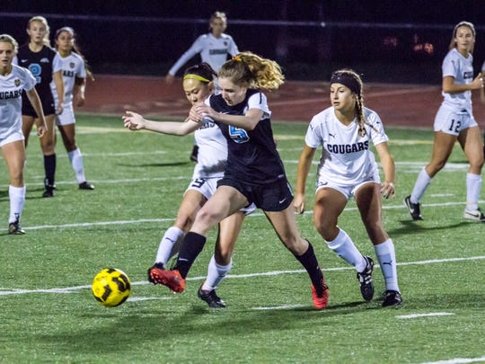 Buena High striker Kaiya Kelly battles with Ventura defender Laura Ellison-Seeger for the ball during the teams' 1-1 tie in a Channel League girls soccer opener Jan. 7 at Larrabee Stadium.