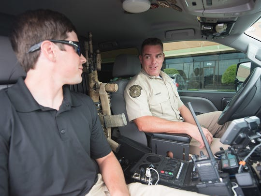 Reid Dunagan, A&M-Corpus Christi Criminal Justice student intern, prepares for a ride-along with game warden Jimmy Lindsey.