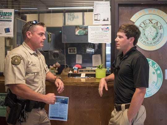 Game Warden Jimmy Lindsey (left) and A&M-Corpus Christi Criminal Justice student intern Reid Dunagan meet at the Texas Parks and Wildlife office.