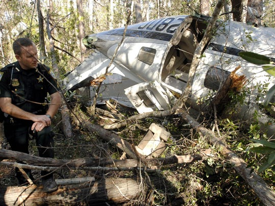 Sgt. Scott Haines looks over the wreckage of the single-engine