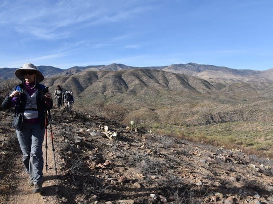Hikers traverse a section of the Bumble Bee segment of the Black Canyon Trail that was damaged by wildfire in 2017.