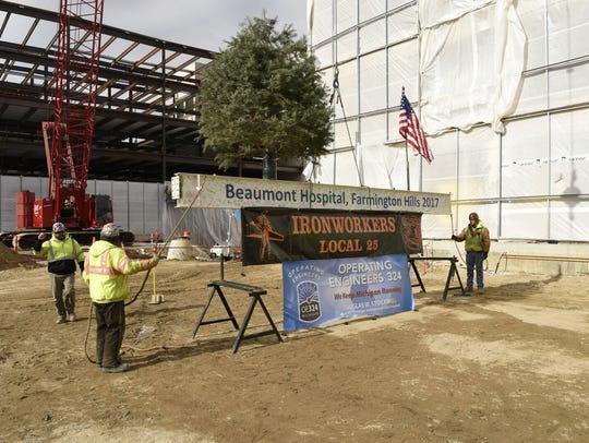 The final construction beam for the Beaumont, Farmington