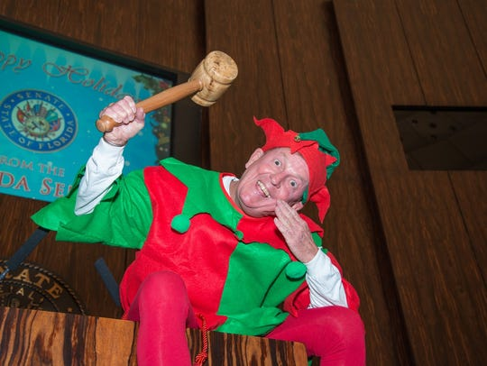 "Tommy Hunt poses as the ""Elf on the Shelf"" in the Senate"