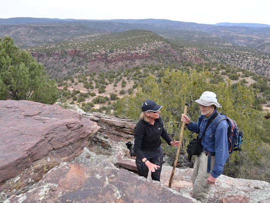 Hikers make the final scramble to the top.