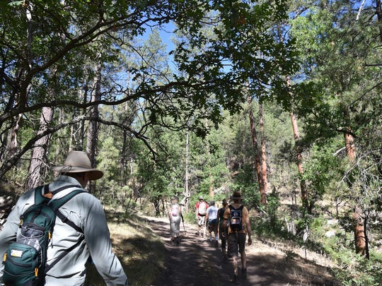 Members of the Payson Packers hike through Pivot Rock Canyon near Clints Well.