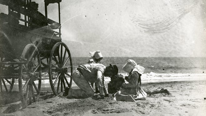 A family is pictured next to their buggy in about the early 1900s on the beach near Rehoboth Beach.