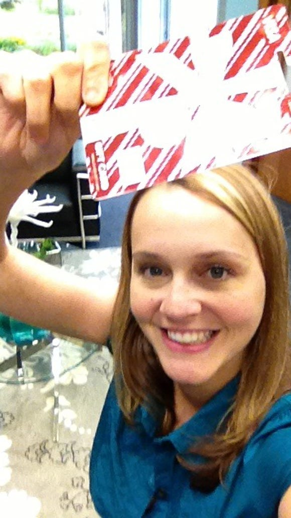 """Bre Brenner, the winner of our """"Super Selfies"""" contest, with her $50 Visa gift card."""