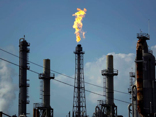 A flame burns at the Shell Deer Park oil refinery in