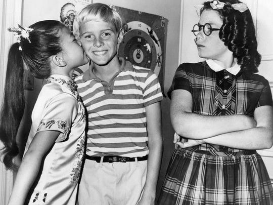 Jeannie Russell, as Margaret, not happy with Cherylene Lee's affection for Jay North in this Dennis the Menace publicity shot