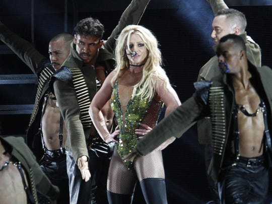 """In this June 13, 2017, file photo, U.S. singer Britney Spears performs during her concert in Taipei, Taiwan. Producers of the new musical stage comedy """"Once Upon a One More Time"""" say their show will use Spears' hit songs, which include """"Oops!... I Did It Again,"""" """"... Baby One More Time,"""" """"Toxic"""" and """"Stronger."""""""