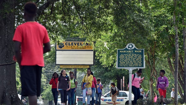 Cleveland High School students leave school in Cleveland,