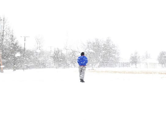 A man walks through the heavy snowfall in Jackson,