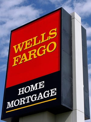 Wells Fargo logo is displayed outside a home mortgage office in Springfield, Ill.