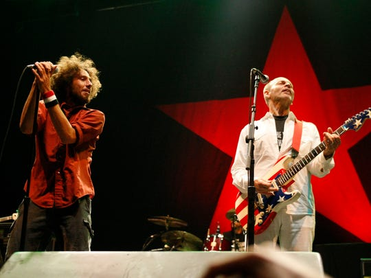 Wayne Kramer (right) played a set with Rage Against
