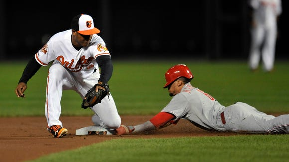Cincinnati Reds center fielder Billy Hamilton (6) steals second base safely as Baltimore Orioles second baseman Jonathan Schoop (6) does not get the throw in time in the first inning at Oriole Park at Camden Yards.